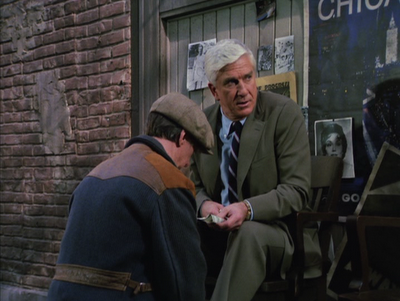 Drebin getting advice from Johnny, the shoeshine guy